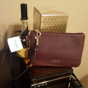 COACH BORDEAUX LEATHER WRISTLET